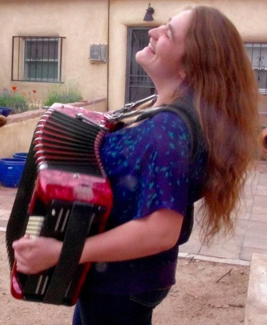 Clara playing accordion
