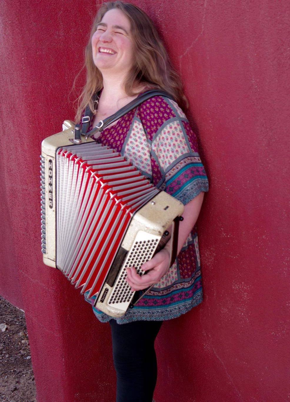 Clara playing accordion